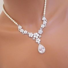 This Bridal necklace set I personally designed and created using high end rhodium plated components set with Swarovski pure brilliance zircons and