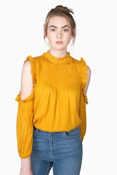 Ruffles and all shades of yellow! Yes please! We love this mustard ruffled top. Mock Neck Cold Shoulder Top #mock #neck #mustard