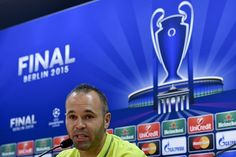 Barcelona's midfielder Andres Iniesta gives a press conference before a training session during the 'Open Media Day' at the Sports Center FC Barcelona Joan Gamper in Sant Joan Despi, near Barcelona on June 2, 2015. Barcelona will play the UEFA Champions League Final 2015 against Juventus at the Olympic Stadium in Berlin on June 6, 2015