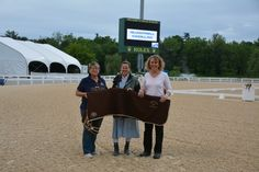 Linda Strine winner of the Spring Warm-Up Open Weighted High Score Championships. Beth Haist with The Horse of Course presenting the winner a cooler. Congratulations!