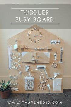 DIy toddler busy/ activity board inspired by Scandinavian design.