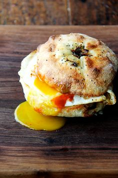 Homemade Bialy with cheddar, fried egg, and Sriracha