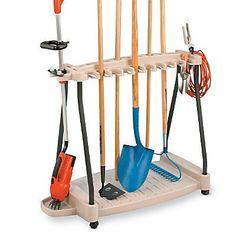 Garden Tool Rack On Wheels - Improvements by Improvements. $79.99. Tool Rack On Wheels stores your garden tools, and rolls them where you need them! Rolling is easier than trying to carry that unwieldy load out of your garage: rakes, shovels, hoes, brooms, lawn trimmer. This Garden Tool Rack holds up to 20 large tools, 17 small tools, a weed trimmer or leaf blower, even your extension cords. Just push the tool handle into the grip to store, pull it out to use. Made...