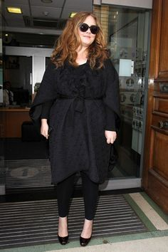 Adele masters the all black winter look.