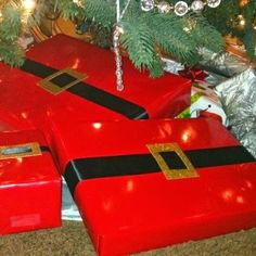Christmas Gift Wrap Idea Red paper, black ribbon, gold gift tag.