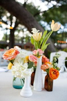 "duh! forget wine bottles and mason jars... i'm collecting small vases for centerpieces... goes very well with the ""shabby chic"" thing, and definitely fits my personal taste better"