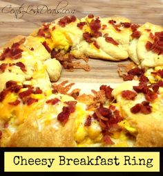 Cheesy Breakfast Ring  Crescent Rolls, Bacon, eggs, cream cheese and cheddar,,, click for recipe