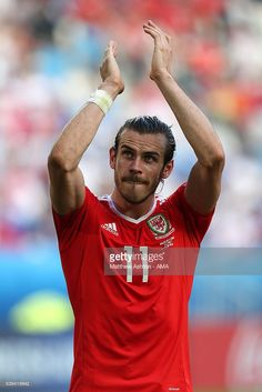 #EURO2016 Gareth Bale of Wales celebrates at the end of the UEFA EURO 2016 Group B match between Wales and Slovakia at Stade Matmut Atlantique on June 11, 2016 in Bordeaux, France.