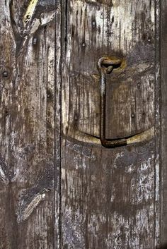 This old catch is on a stable door - wonder how many hands over how many years it has taken to wear this groove in the wood.