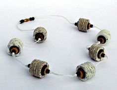 book page and button necklace