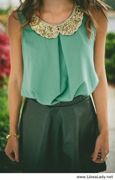 Love the dark green in skirt with the mint colored top set off by an awsome collar.