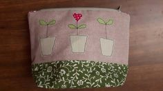 Check out this item in my Etsy shop https://www.etsy.com/uk/listing/268434254/lovely-3-flower-pot-applique-zip-bag