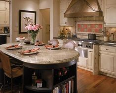30 Best Oval Tables Ideas You'll Love - InteriorSherpa Kitchen Island Dining Table, Grey Kitchen Island, Kitchen Island With Seating, Granite Kitchen, Kitchen Cabinets, Wooden Kitchen, New Kitchen, Kitchen Decor, Kitchen Ideas