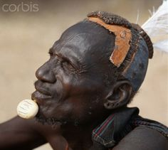 Kenya, Turkana elders wear decorative ivory lip ornaments, secured in position by a spigot which is inserted in a hole pierced below the man...