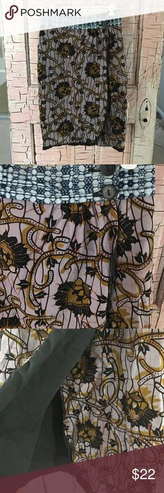 "Amani Africa boho skirt A company that helps African women.  Cute skirt!  Wrap style with two buttons.  EUC.  Measures 25"" long and 13 1/2"" flat across the waist approximately Amani Africa Skirts Midi"