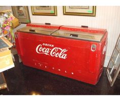 Antique Coca Cola refrigerated case with bottle opener. I WANT!