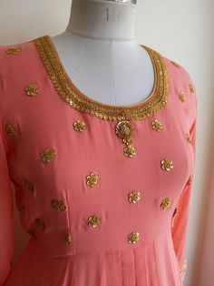 """Coral hued Georgette Front Open Style Kurta with intricate """"Mardodi"""" work. Combined here with our 'Gold Skirt' from the 'Lowers' Collection. Fabric : Viscose Georgette Lining : Shantun Shop now on www.labelkanupriya.com"""