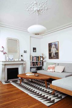 tall white living room with ceiling medallion and modern lantern light fixture / sfgirlbybay