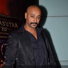 An actor poses for the camera from movie Kamasutra 3D during the movie trailer launch at PVR Mumbai.
