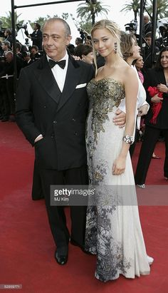 Chopard's owner Fawaz Gruosi and Beatrice Borromeo pose as they arrive for the screening of the film 'Broken Flowers', 17 May 2005 at the 58th edition of the Cannes.