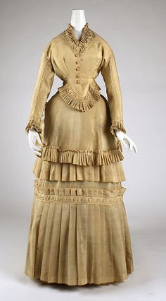 1870-1874 wool and cotton Dress, European. Via MMA. (front view)