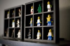 Shadow boxes for their fav minifigures. Would def paint in a cheerier color, though!