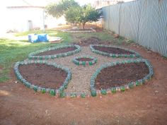 Horta mandala feito com garrafa pet