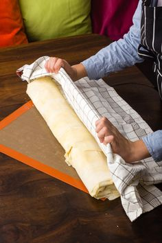 Roll it on a baking sheet, seam side down. Use a parchment paper to lift the strudel. Apple Strudel, Cooking Equipment, Parchment Paper, Baking Sheet, Kitchen Tools, Diy Kitchen Appliances, Kitchen Gadgets, Cooking Tools, Apple Strudle
