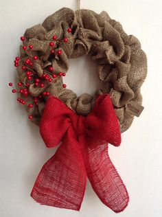Red berries and red bow for Christmas. Love it. Could easily change this seasonally. Just switch out berries and bow every holiday. Make it so they are easily detachable.
