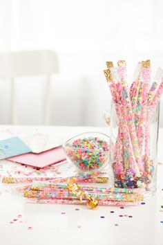 confetti filled straws.  use clear boba tea straws.  fun party favor or something to take to a park. or something.