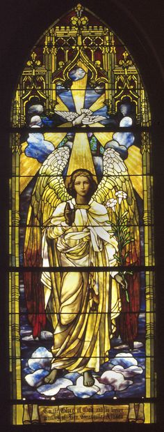 The East Angel Window.  Because of their exposures and how they caught the sun, they are referred to as the morning and evening angels.  Mrs. D. P. Hadden gave both windows, on the west in memory of her mother, Mrs. Mary Ann Hudspeth Boyd, and on the east in memory of the Rev. Granville Allison, first rector of Grace Church.  The Angel Windows are two of seven Grace-St. Luke's windows originally installed in Grace Church.