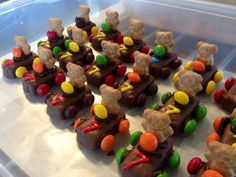 Teddy Graham Race Cars -- Fun size Snickers (or Milky Way or Muskateer), Teddy Graham's (cut in half), M & Ms (cut the ones used for steering wheel in half), icing to stick on everything, and add the age of your child as the race car number!  TOO CUTE!!!