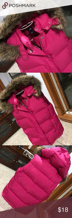 Gap down vest Vest with zipper and snap flap closure. Hood with faux fur trim is detachable. Side snap pockets. GAP Jackets & Coats Vests