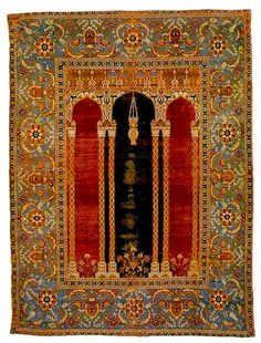 The central red and black of this Bursa Prayer Rug (Turkish) is stunning. I love rugs!