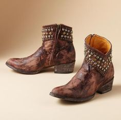 """Old Gringo® does handmade booties to wear in any weather, cut to the ankle with a studded hi-lo cuff. Brown leather with unique hand brushed finish, leather sole, chunky 2"""" heel, side zip. Imported. Whole and half sizes 6 to 10, 11.View our entire Old Gringo Collection."""
