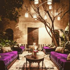 Courtyard with purple draped couches/ daybeds and lanterns | Morocco.