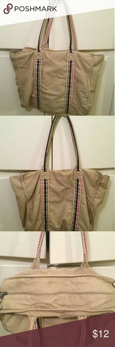 """Tan Canvas Bag Used tan canvas bag with multi color stripes. Very casual!  Inside has a couple pockets.   • Max of 48 hr hold • Bundling saves you money!!   • NO SWAPS/TRADES • Will ship next business day after purchase, EXCEPT on Sundays. • Please ask any ???'s or for more pics.  • Offers will only be considered when using """"Make Offer""""! Bags Totes"""
