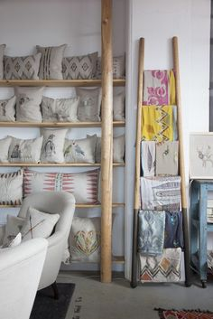 Neutral, graphic pillows with wood shelves and ladder // Coral & Tusk Studio…