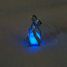 "http://rubies.work/0680-sapphire-ring/ Mermaid's Magic ""White Gold"" - Midnight Blue Glow in the Dark Pendant with Glowing Essence of the Sea - White Gold Plated"