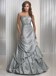 """<p><strong>Descriptions</strong>: Formal silver evening dress with figure flattering pleats throughout the bodice and a band of beads and jewels at the natural waistline, an A-line silhouette in shimmer taffeta with a caught-up skirt and a corset back. <br /><span style=""""font-weight: bold; font-size: 12px; color: #dc6694; line-height: 16px; font-family: verdana,arial;"""">Colors Available</span><br />Fuchsia, Purple, Shimmer Silver and more to contact us.</p> <p><strong>Fabric:</strong> ..."""