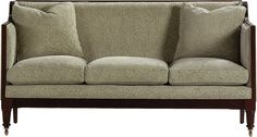 A Hepplewhite Settee with a reeded frame. Tight back and crisply tailored seat cushions. Round tapered legs on casters.