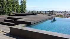 Soak up the sun and enjoy the view in this modern pool! Pool Chairs, Modern Pools, Illusions, Backyard, The Incredibles, Landscape, Architecture, Awesome, Building