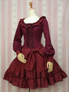 A pretty Victorian Maiden dress, with long ruflfed sleeves and a low slung waist bow.