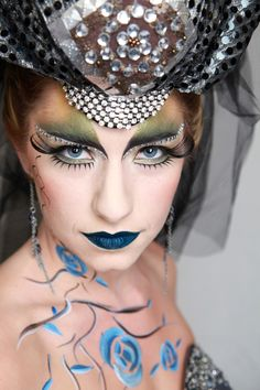 Alice in Wonderland themed fantasy make-up with crystals accented eyebrows and painted roses.