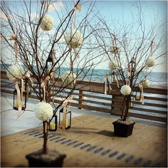 Ceremony decor by Holiday House Weddings and Events at Jennette's Pier