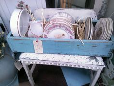 Old wooden tool box painted teal with vintage china