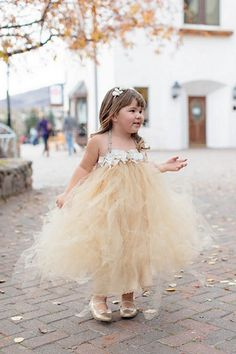 Glamorous Gold, Green & White Wedding | Confetti Daydreams - Adorable flower girl wearing muted gold dress