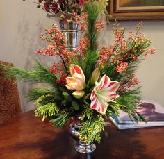 A unique holiday arrangement featuring gorgeous amaryllis   www.amaranthusonmain.com