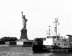 "The Statue of Liberty can be seen beyond a United States Coast Guard Cutter, standing ready to serve and protect. The Coast Guard's motto is Semper Paratus, meaning ""Always Ready""."
