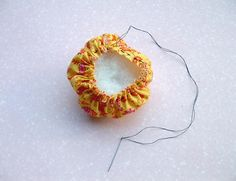 I saw a ring version of this over at Camilla's a couple months back and I thought it would make a quick, easy stocking stuffer for a crafter. Here's a short tutorial for a wrist version (sorry about all the. Pincushion Tutorial, Sewing Projects, Projects To Try, Mochi, Felt Crafts, Pin Cushions, Stocking Stuffers, Crochet Earrings, Things To Think About